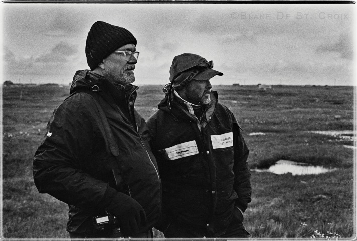Blane De St. Croix with Climate Scientist Craig Tweedie looking across the Arctic's Permafrost, Utqiagvik, AK, photo. Paul DeLuna