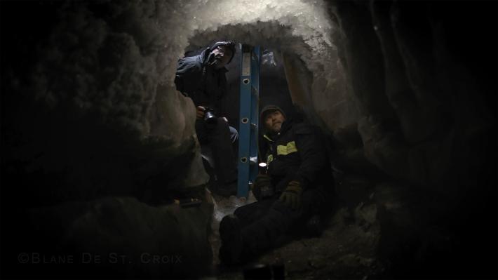 Artist with climate scientist Craig Tweedie, thirty feet below a giant ice wedge in research ice cavern dated 75,000 years, Utqiagik, AK