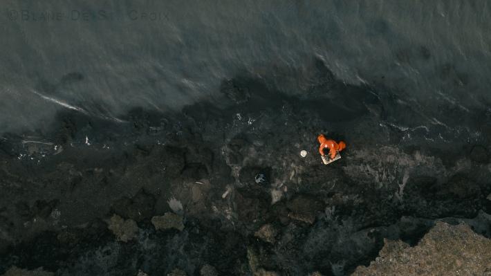 Artist plein air of permafrost eroding into the Arctic Ocean, High Arctic, Utqiagvik region, AK